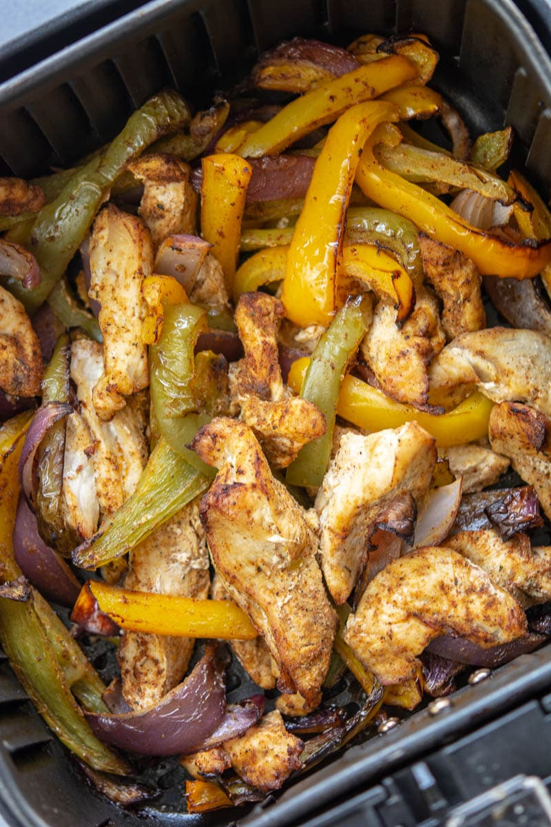 chicken and veggies in a skillet