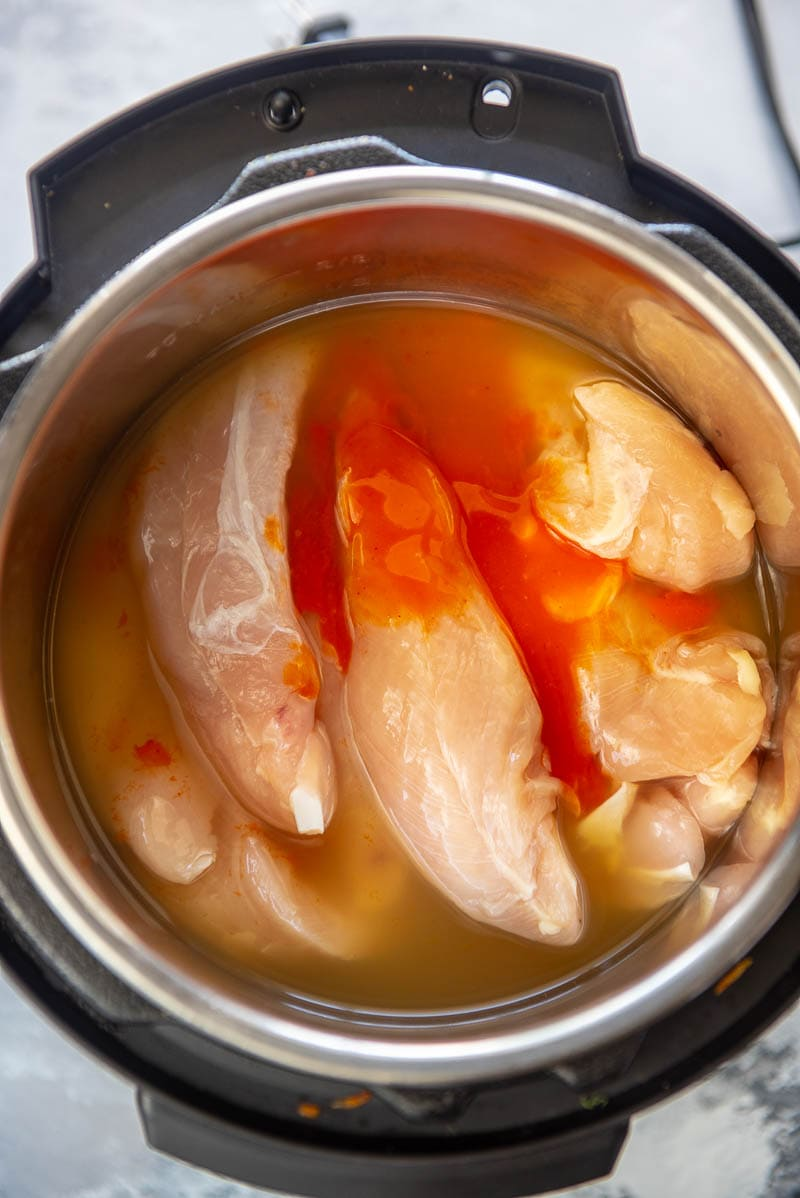 chicken and bufflo sauce in an instant pot