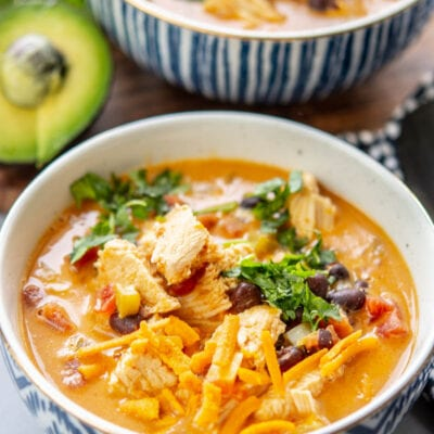 chicken fajita soup in a bowl with garnish