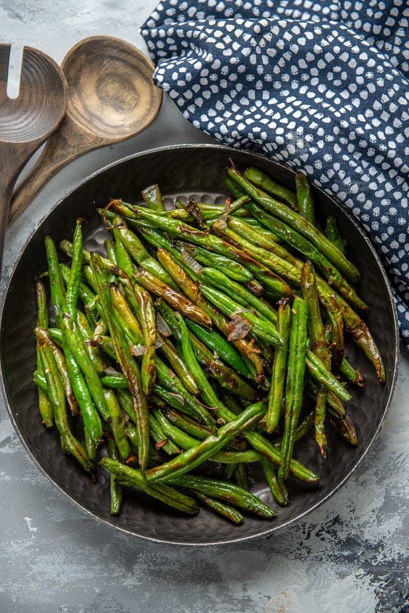 air fryer green beans with a spoon