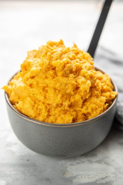 mashed sweet potatoes in a bowl with spoon