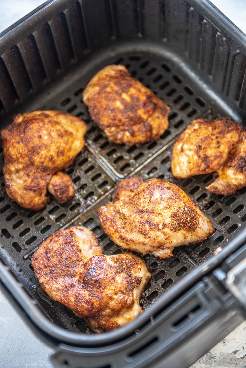 cooked chicken thighs in an air fryer