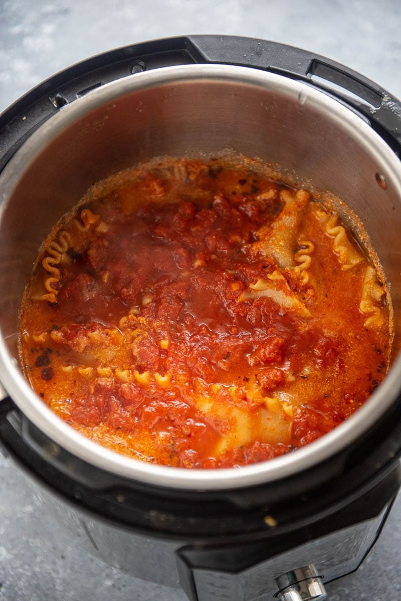 cooked lasagna noodles and sauce in Instant Pot