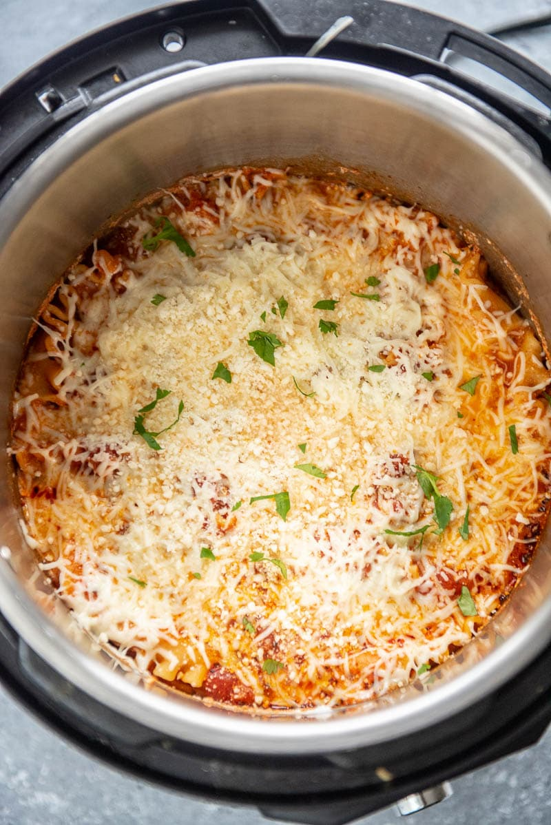 instant pot with cooked cheese lasagna topped with parmesan and parsely