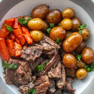 pot roast on a plate with potatoes and carroots