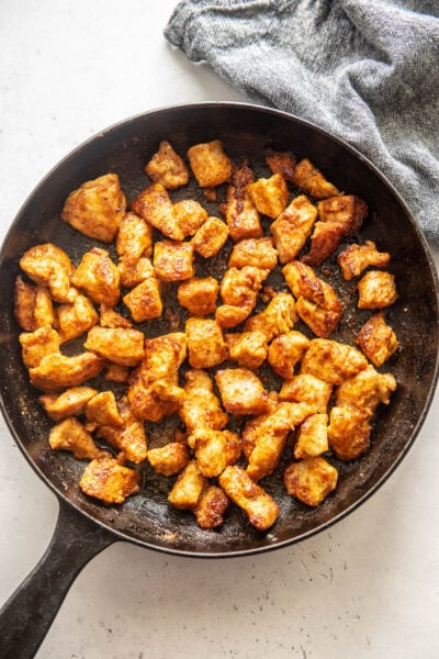 cajun chicken bites in a cast iron skillet