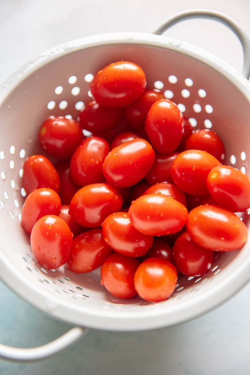 grape tomatoes in a colander