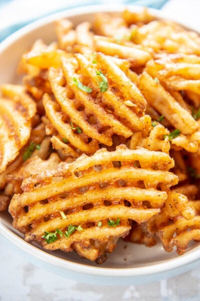 closeup of waffle fries in a bowl