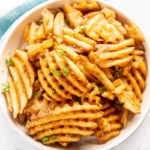 waffle fries in a white bowl