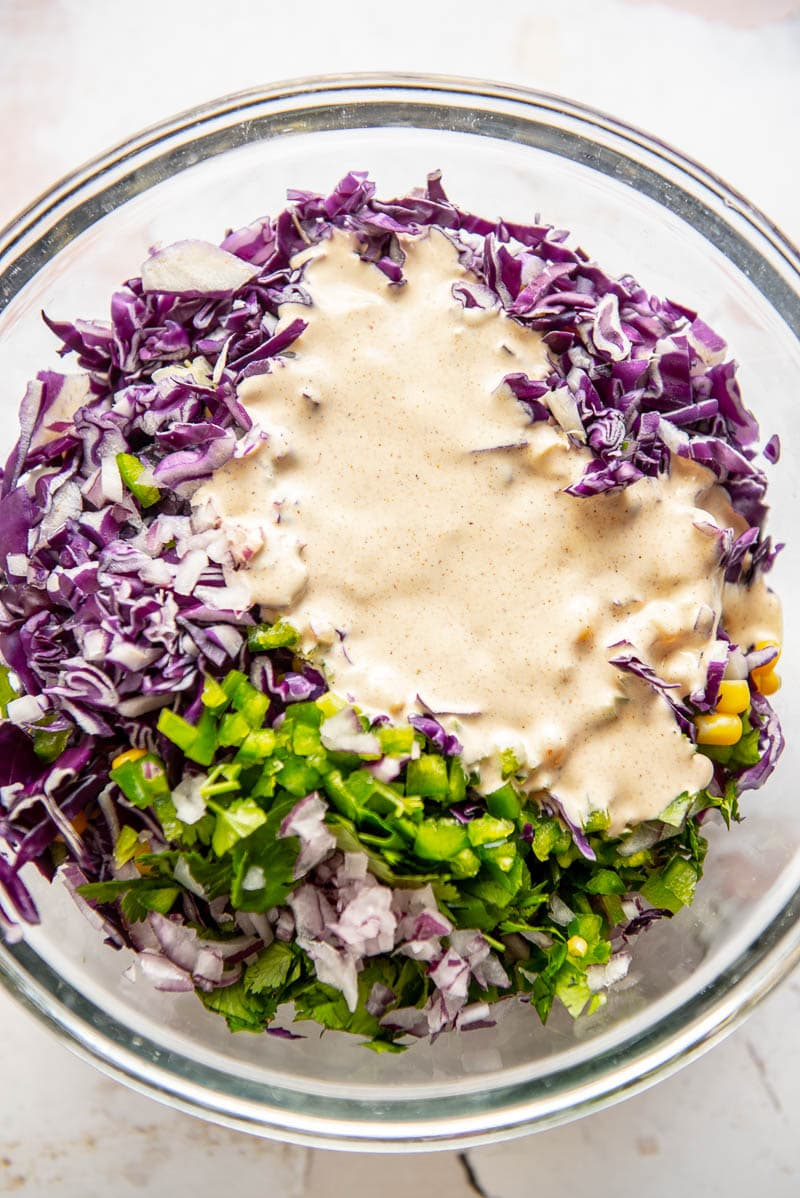 ingredients for corn slaw with dressing on top