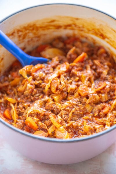 pink dutch oven with beef and cabbage casserole