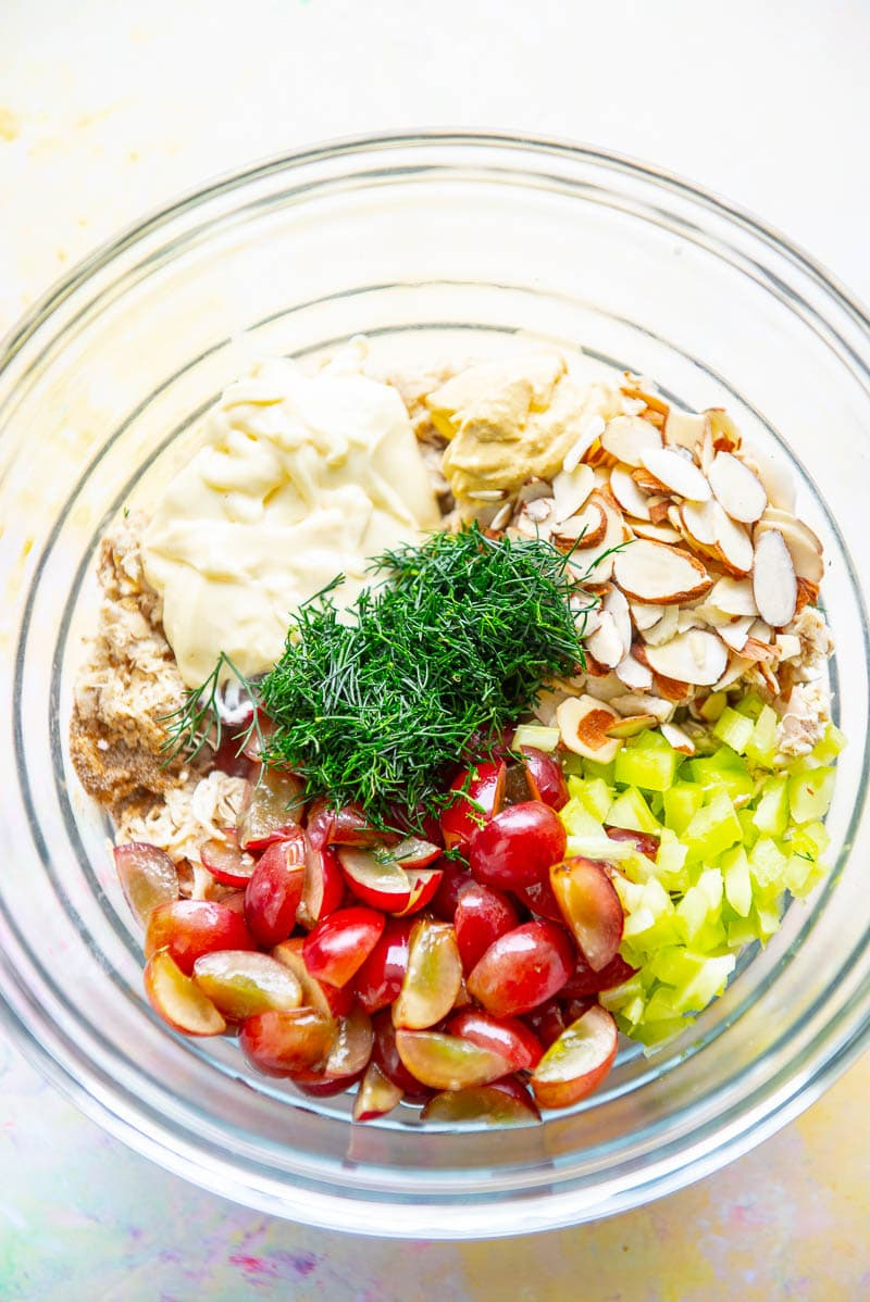 glass bowl filled with all chicken salad ingredients