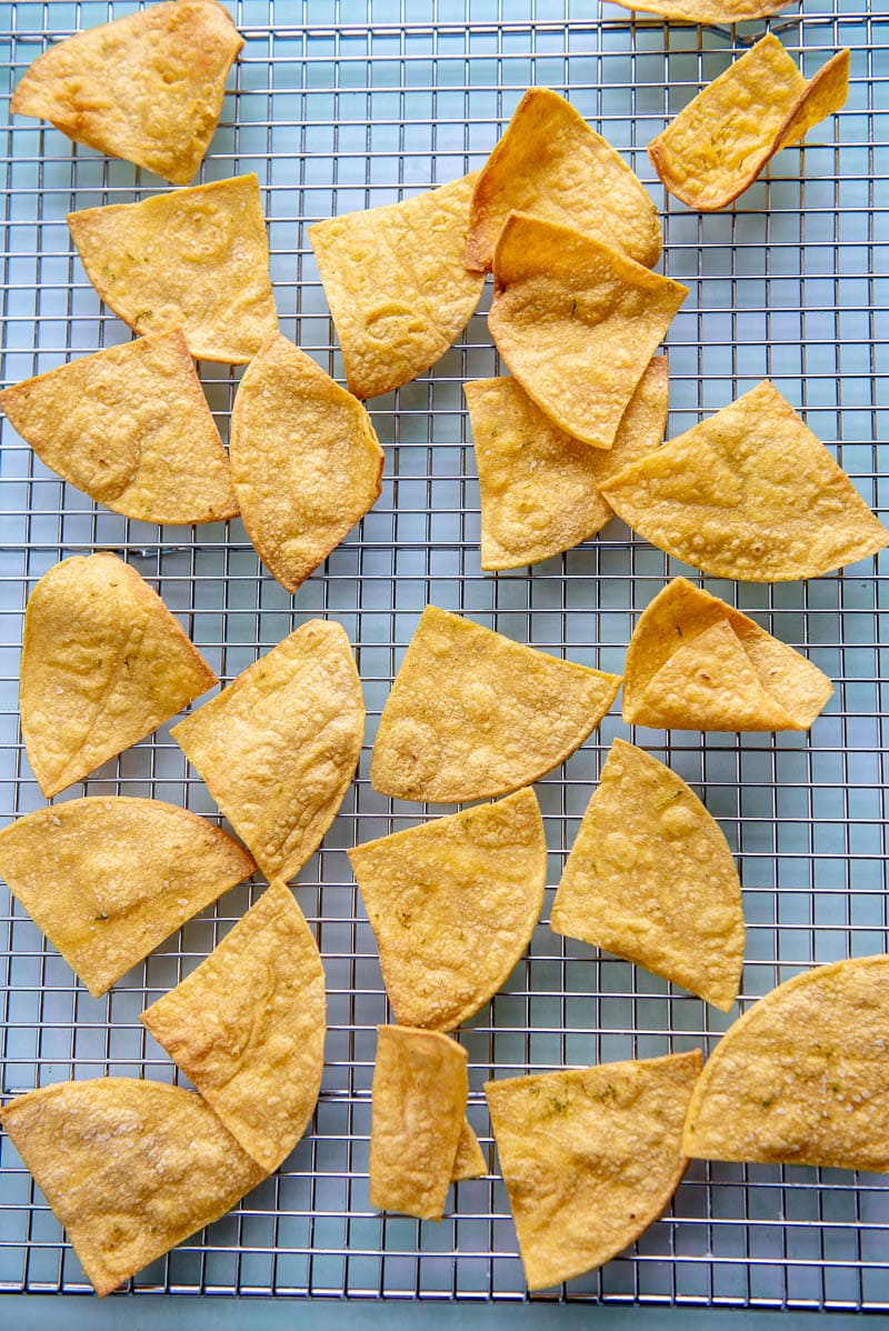 cooling rack with tortilla chips from the air fryer spread out