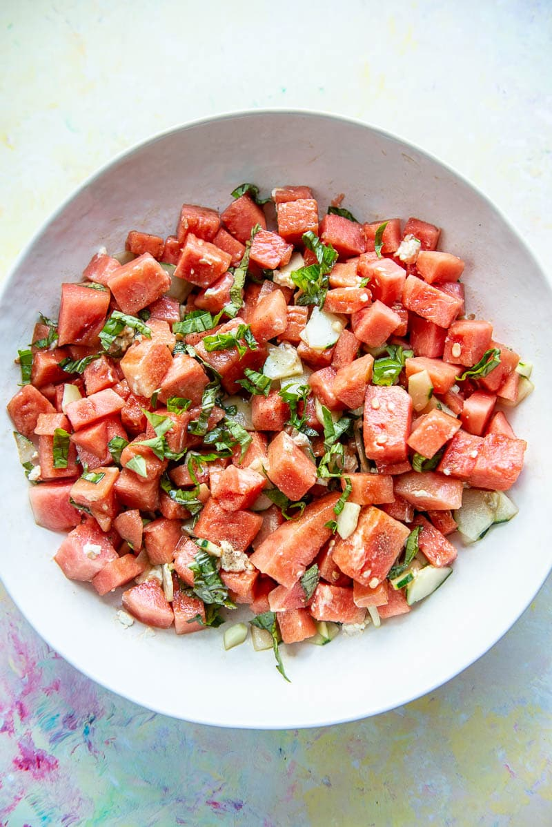 large white bowl filled with watermelon salad